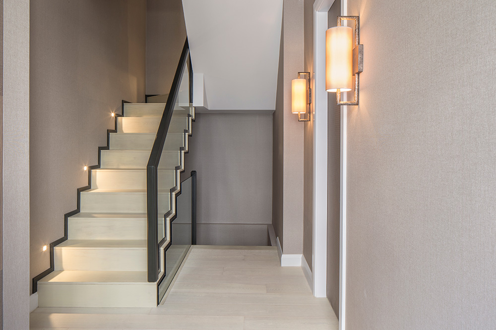 luxury entrance hallway with staircase lighting