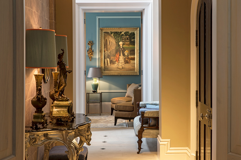 luxury entrance hallway with elegant console table and ornate table lamps
