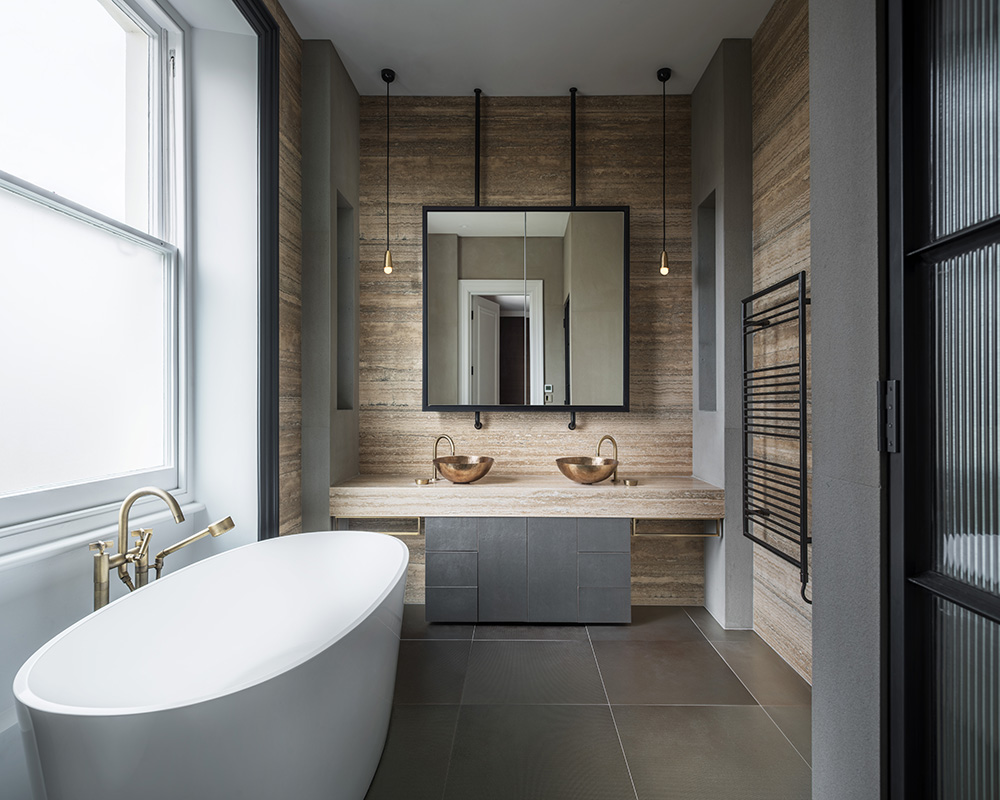 contemporary industrial style bathroom with marble vanity and oval freestanding bath