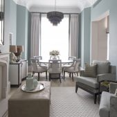 Luxury reception room with glass chandelier above circular dining table