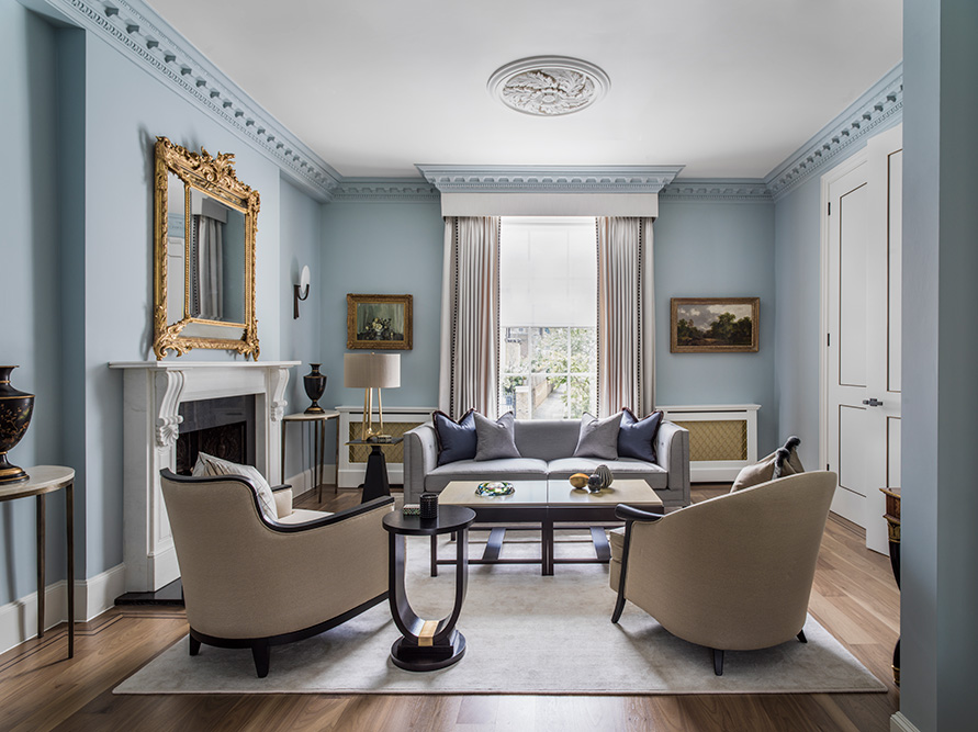 classic contemporary living room with blue walls and bespoke furniture