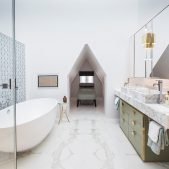 luxury spa bathroom with freestanding bath, marble vanity unit and day bed