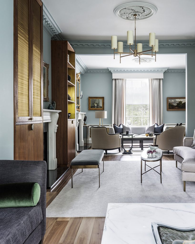 elegant blue living room with bespoke blue bench and oval marble coffee table