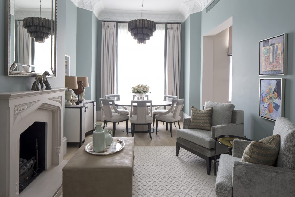 A classic-contemporary living room with pale blue walls and bespoke furniture by luxury interior design studio Roselind Wilson Design