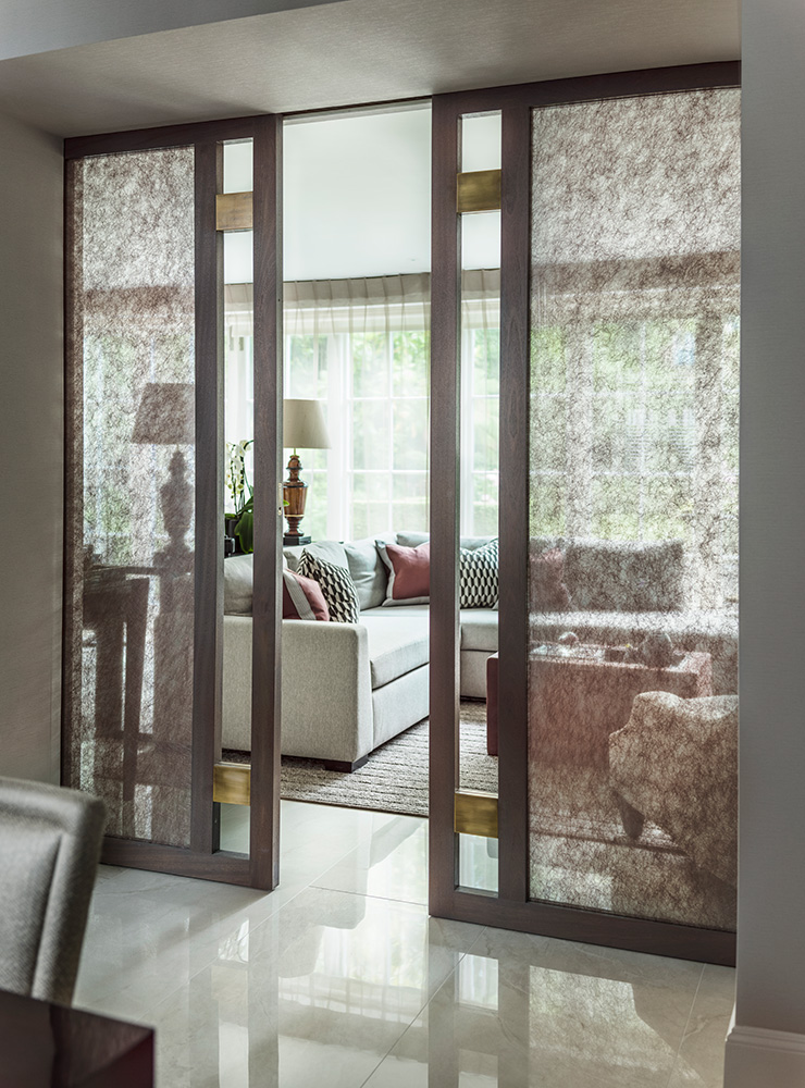 Contemporary living room with metal and timber pocket doors