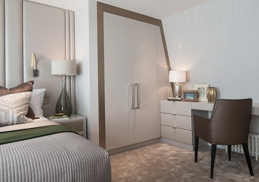 Tranquil master bedroom with a neutral colour palette and bespoke built-in cupboards
