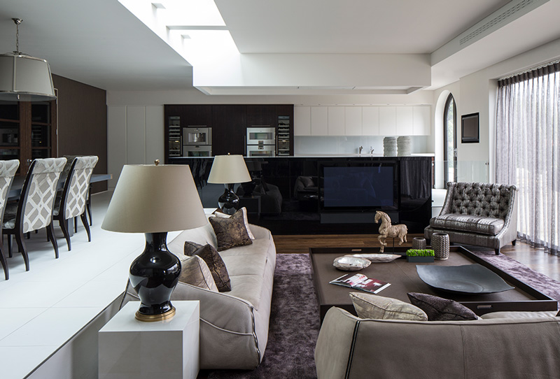 open plan entertaining space with kitchen, dining and living room decor
