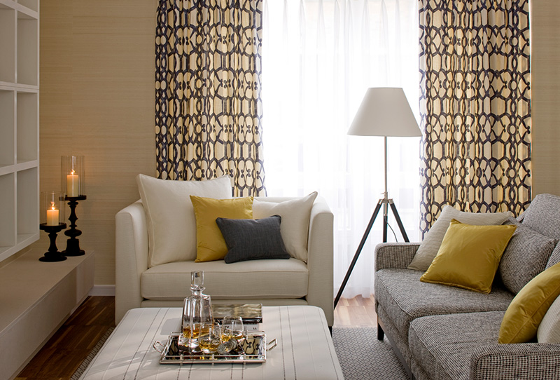 modern living room in neutral colour palette of grey, white and gold