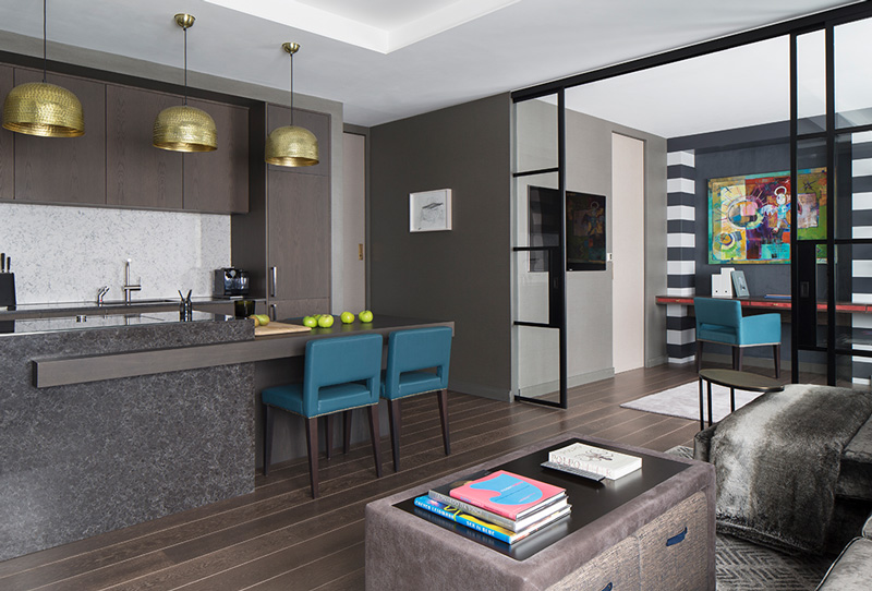 open plan kitchen and living room with metal-framed internal doors