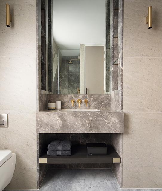 bespoke marble bathroom vanity with symmetrical brass wall lights